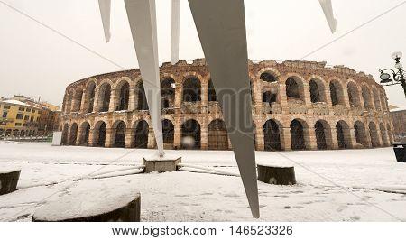 The Arena di Verona in winter while it snows (I-III century). (UNESCO world heritage site). Veneto Italy Europe