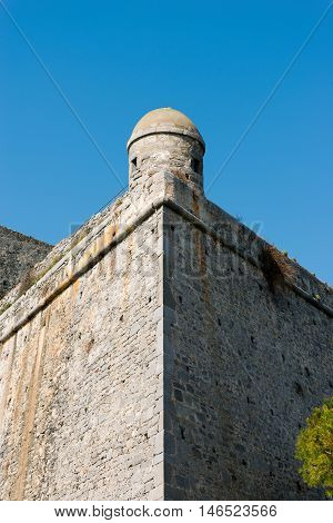 Detail of the Doria Castle (1164-XIX century) with a sentry box on a clear blue sky in Portovenere town (UNESCO world heritage site) Liguria Italy