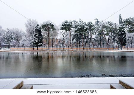 Little pond in winter with snow in Verona City (UNESCO world heritage site). Veneto Italy Europe