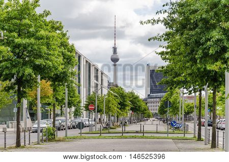 Berlin Germany - August 14 2016: Paul Loebe Alley with Paul Loebe House to the left 25 stores international trading center and television tower
