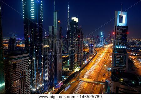 Dubai United Arab Emirates - March 24 2011 - View of Dubai skyline at night from 42th floor terrace of hotel at Sheikh Zayed Road