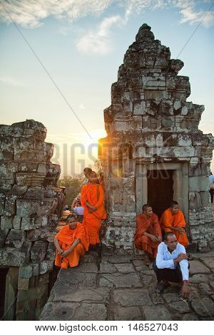 Angkor Wat Cambodia - March 19 2011 : Group cambodian buddhist monks at Angkor Wat at sunset