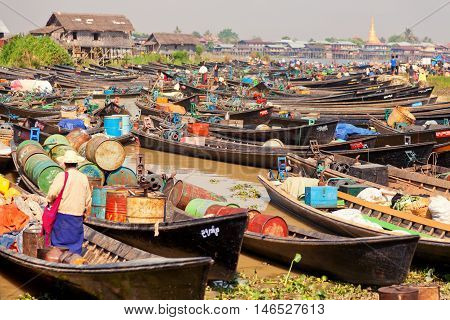 Heho Myanmar - March 02 2011 - Burmese people trading at an floating market. Boats are full of gasoline and other goods