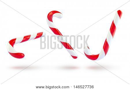 Three sweet traditional Christmas holiday caramel canes. 3d rendering. Raster. Festive sweets isolated white background illustration