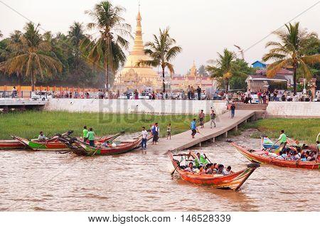 Yangon Myanmar - February 24 2011 - Burmese people feeding the hungry seagulls on the pier of Yangon at sunset