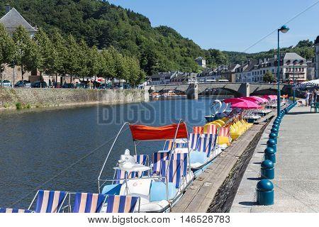 BOUILLON BELGIUM - AUG 13: Belgian river Semois with pedalos for recreation on August 13 2016 in Bouillon Belgium