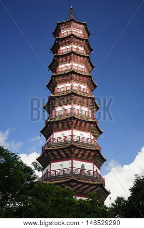 The Chigang Pagoda rising about a small park in the Haizhu district of Guangzhou china on a sunny blue sky day in Guangdong province.
