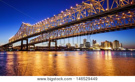Crescent City Connection Bridge carries traffic over the Mississippi River into New Orleans at night