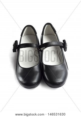 Front view on pair of black shoes for girl on white background