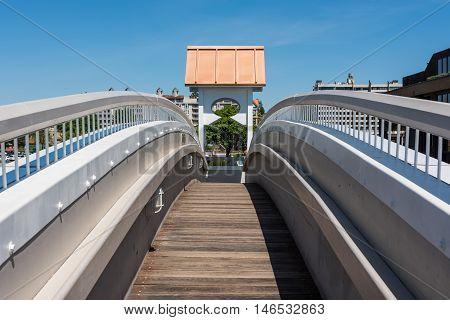 Curved, arched bridge on world's longest floating boardwalk in Coeur d'Alene, Idaho