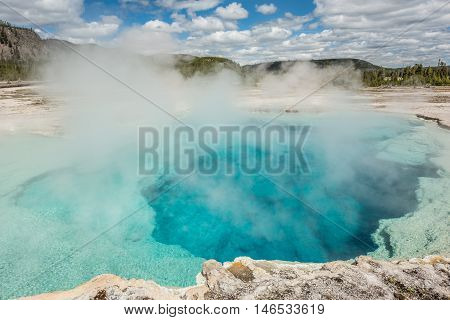 Deep blue Sapphire pool in biscuit basin in Yellowstone National Park hot spring