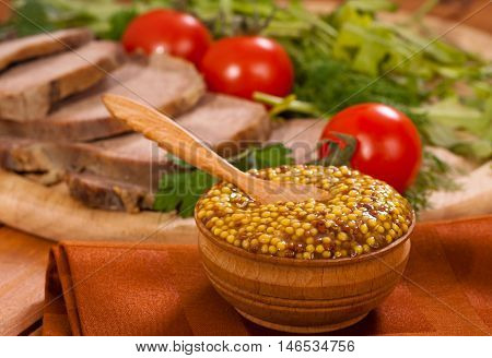 Mustard with tomatoes and meat horizontal closeup shot