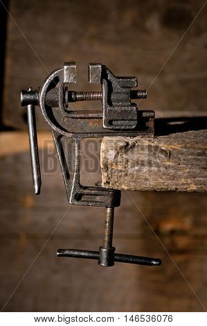 Old rusty vise tool still-life in dark colors