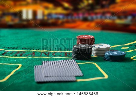 Poker chips on a poker table at the casino