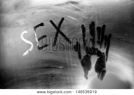 concept photo of sex in the bathroom. Inscription SEX on the mirror.