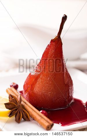 Poached pear in red wine and cinnamon vertical