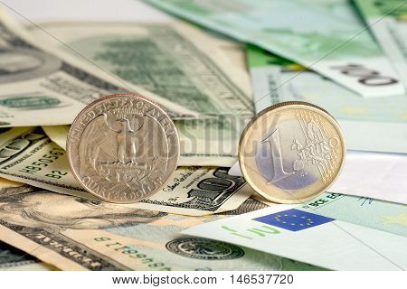 Quarter dollar and euro on banknotes  background