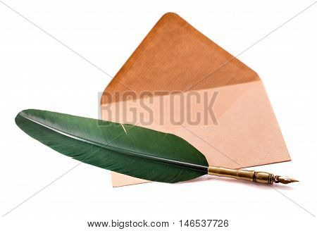 Quill pen and retro envelope isolated on white