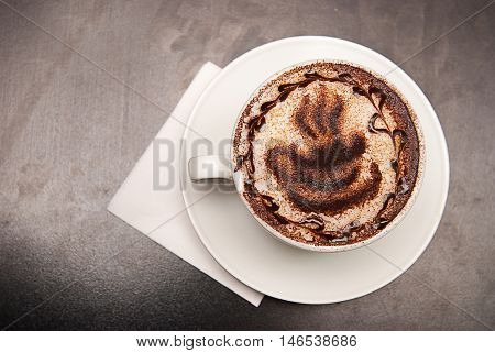 cappuccino coffe cup with picture on the table