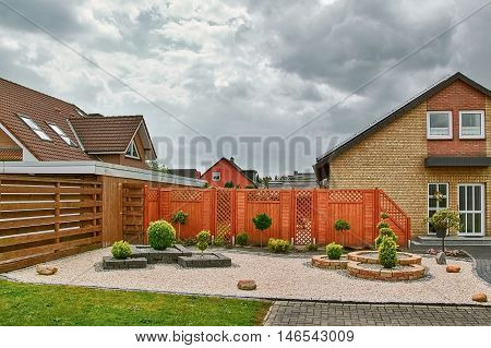 Сourtyard of House under the Cloudy Sky