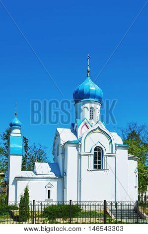 White Ortodox Church in Daugavpils against Blue Sky, Latvia