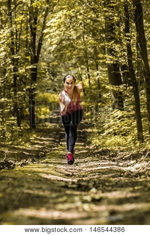 Sports Girl Runs On A Footpath In The Woods