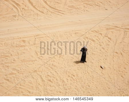 A lone figure standing in the desert.
