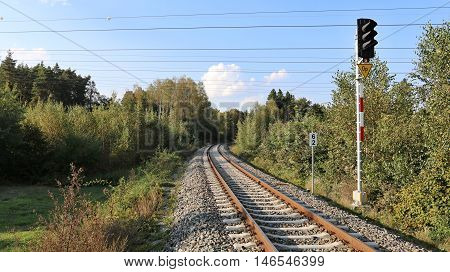 single-track railway line in the countryside .