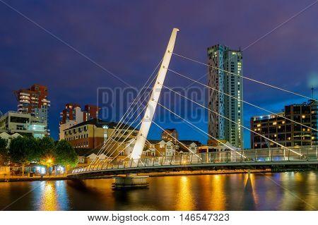 London United Kingdom - July 23 2016: Beautifully lit Canary Wharf footbridge at night