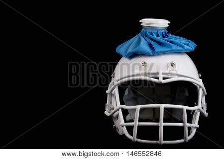 American football helmet, with a ice pack on top, injured player or team is having a bad season.