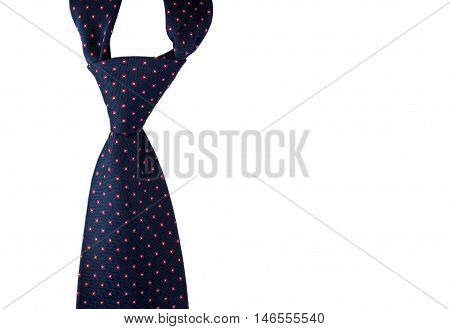 Close-up photo of dark blue men's tie isolated on white