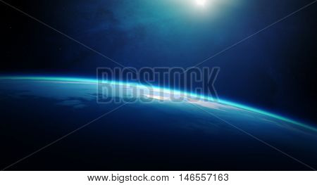 Sunrise over planet Earth with cloudy ocean and viewed from deep space