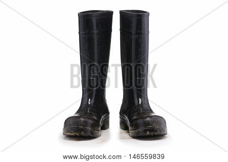 Wet dirty Mud boots isolated on pure white background front view