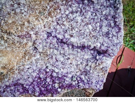 Amethyst druse over beige rock. Ontario, Canada.