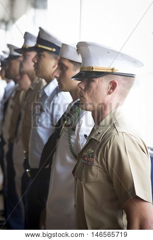 NEW YORK MAY 30 2016: Military personnel from United States Armed Forces standing during the annual Memorial Day Observance service on the Intrepid Sea, Air & Space Museum during Fleet Week NY 2016.