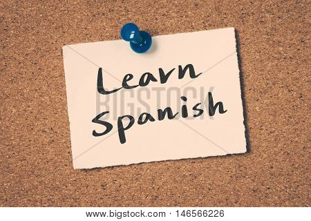 Learn Spanish note pin on the bulletin board