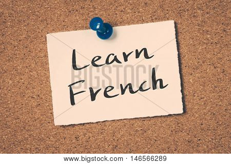 Learn French note pin on the bulletin board