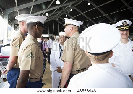 NEW YORK MAY 30 2016: LT General John Wissler, Commander, U.S. Marine Corps Forces Command with Marines and sailors at the Memorial Day Observance service on the Intrepid Sea, Air & Space Museum.