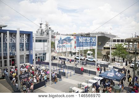 NEW YORK MAY 30 2016: The entrance to the Memorial Day Commemoration ceremony at the Intrepid Sea Air & Space Museum with the USS Bataan (LHD 5) moored at Pier 88 during Fleet Week NY 2016.