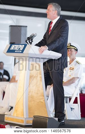 NEW YORK MAY 30 2016: Mayor Bill De Blasio speaks at the annual Memorial Day Observance service on the Intrepid Sea, Air & Space Museum in Manhattan during Fleet Week NY 2016.