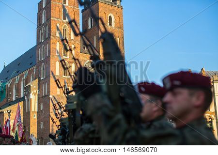 KRAKOW, POLAND - FEB 10, 2016: Polish soldiers on guard of the ceremony is the vow of first classes of the Jan III Sobieski High School (founded 1883) at the Main Market Square near St.Mary Cathedral.