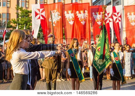 KRAKOW, POLAND - FEB 10, 2016: Unidentified participants of ceremony is the vow of first classes of the Jan III Sobieski High School (founded in 1883) at the Main Market Square near St.Mary Cathedral.