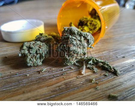 medical marijuana pouring out of a prescription bottle