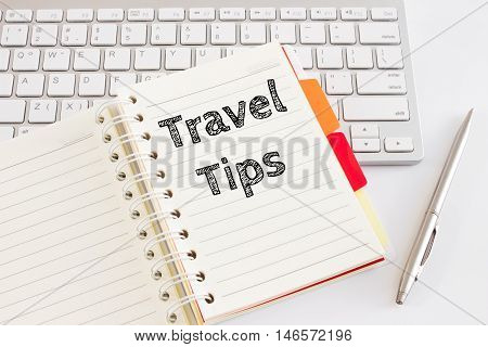 Word text Travel tips on white paper on office table / business concept
