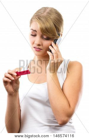 Worried Woman With Phone Informing Someone About Positive Pregnancy Test