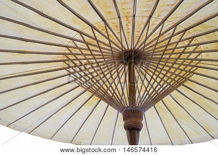 Isolated Thai traditional wooden umbrella - underview handcraft umbrella made from bamboo