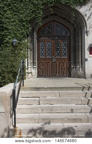View of ivy surrounding Gothic doorway and stairs