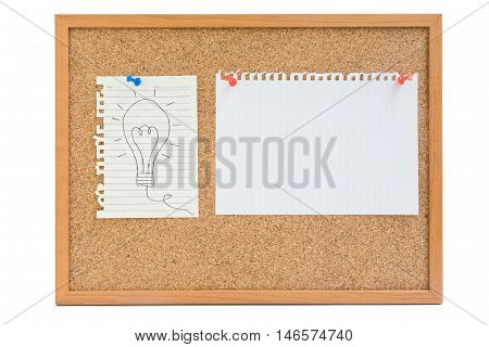 Isolated hand writing light bulb on white paper with empty white paper pin on the wooden board - concept of idea work