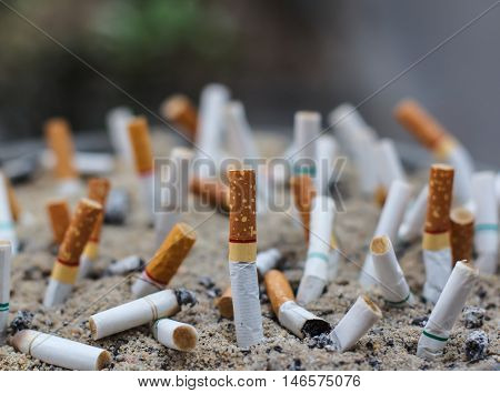 Cigarette butts in the ashtray dirty, Drugs Not good for health and illegal
