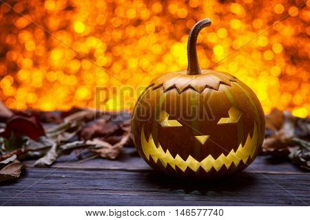 Pumpkin for Halloween, lamp pumpkin, antique wood, celebrating halloween, smiley on a pumpkin, autumn dry leaves, bright background